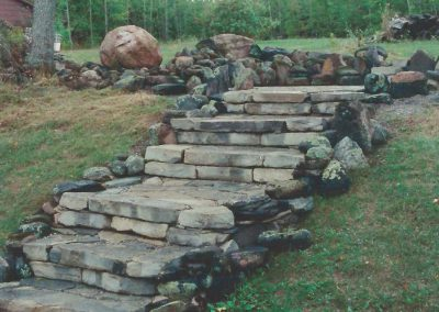 Landscapes synchronic with the natural environment.  Cemented or dry stack free standing and retaining walls, pathways, patios, found-stone sculptures and fireplaces.